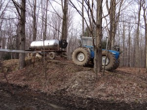 A tank of sap from a collection point is brought to the Sugarbush for unloading