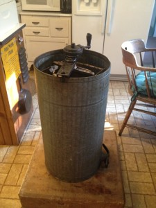 Antique hand crank honey extractor